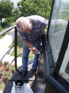 Hobie works on siding of Concord Point cupola.
