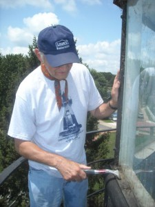 Tony Pasek working on siding of cupola at Concord Point.