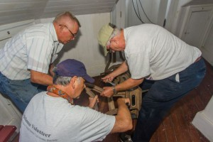 Photo by Bob Stevenson Hobie, Tony and Ray Brown fit the legs onto the frame.