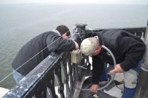 Volunteers Bob Stevenson and Karl Talbott work on bird squawker.