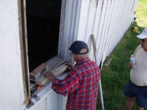 Hobie reinstalling one of the windows.