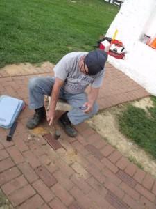 Hobie taps in last brick.