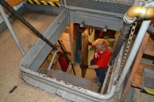 Lauren hauling wood from drill press room to upper deck.