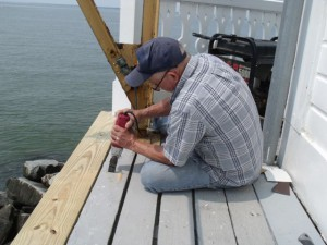 Hobie replacing deck boards.