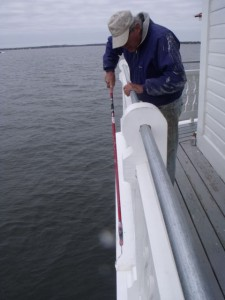 Steve Blakely paints outer deck board