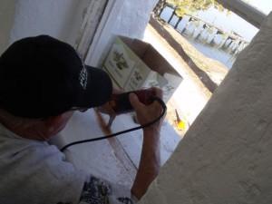 Hobie repairs tower window.