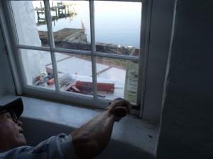 Hobie repairs mid-level window in tower