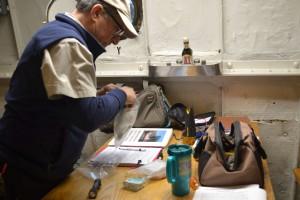 Greg organizing materials