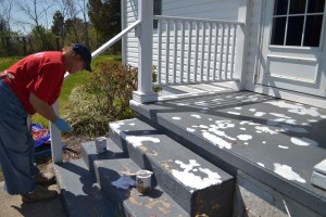 Joan Spiece puts primer on steps.