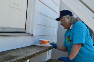 Paula Liebrecht painting door trim.