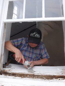 Hobie working on window.
