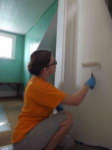 Claudia Talbott painting stairwell