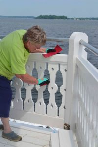 Cathy sanding newest pickets.