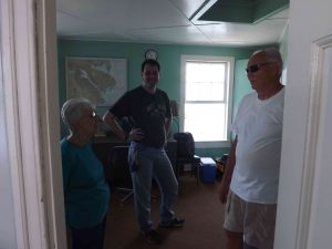 TPSLH guest (left) talks with Karl Talbott (center) and Capt. Howard (right) about the LH's history