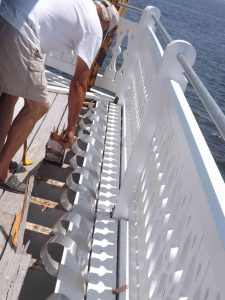 Captain Howard works on the 4th side of the exterior deck