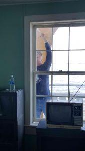 Jeff painting exterior window.