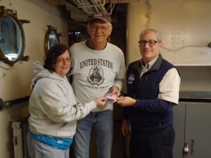 Tony receives 1000 Hour Volunteer Patch from Greg and Anne