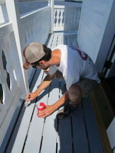 Craig Swift painting the deck.