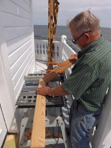 Hobie cuts siding for equipment room.