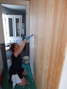 Lauren Schmitz - paints the equipment room hall way siding.