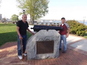 Friends volunteer (Left) Floyd Dobson and Hobie with freshly painted cannon.