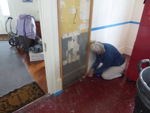 Mary working on the floor molding.